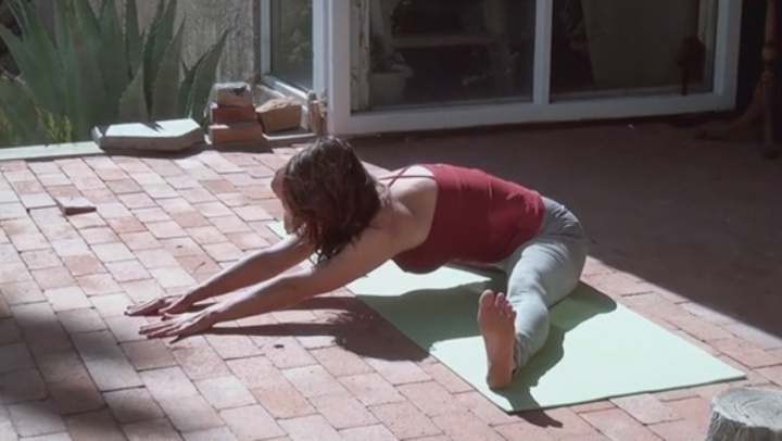 A Beginner's Guide to Yoga Poses - Seated Straddle to...
